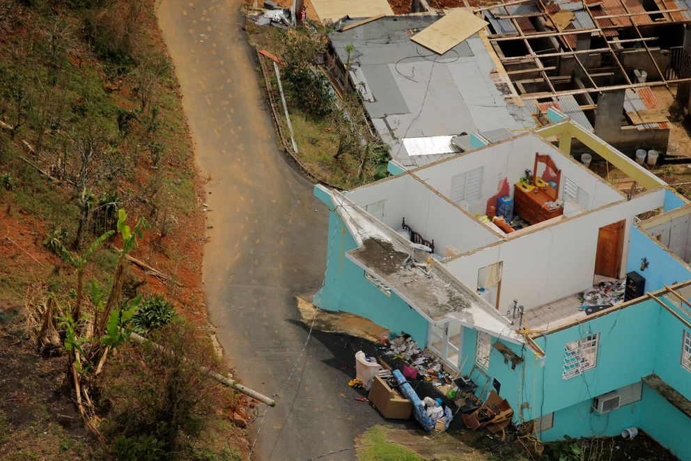 The interior contents of a home are seen from the air during recovery efforts following Hurricane Maria near Utuado, Puerto Rico, October 10, 2017. REUTERS/Lucas Jackson