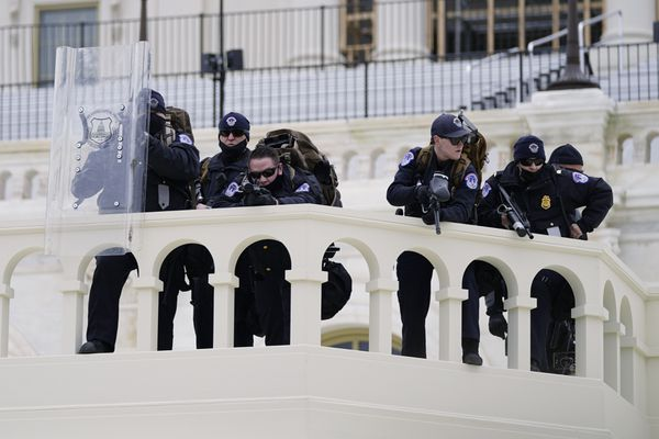 FILE - In this Jan. 6, 2021, file photo, police keep a watch on demonstrators who tried to break through a police barrier at the Capitol in Washington. A blistering internal report by the U.S. Capitol Police describes a multitude of missteps that left the force unprepared for the Jan. 6 insurrection — riot shields that shattered upon impact, expired weapons that couldn't be used, inadequate training and an intelligence division that had few set standards. (AP Photo/Julio Cortez, File)