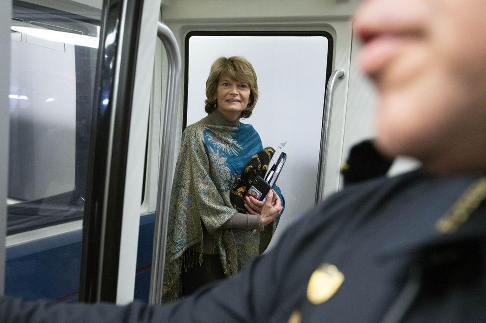 Sen. Lisa Murkowski, R-Alaska, stands on the Capitol subway on Capitol Hill in Washington, Monday, Feb. 3, 2020. (AP Photo/Jose Luis Magana)