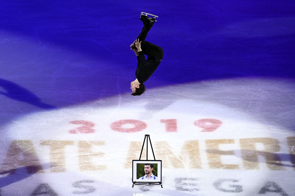 Keegan Messing, right, of Canada, performs in honor of his late brother Paxon during the International Skating Union Grand Prix of Figure Skating Series exhibition Sunday, Oct. 20, 2019, in Las Vegas. (AP Photo/David Becker)