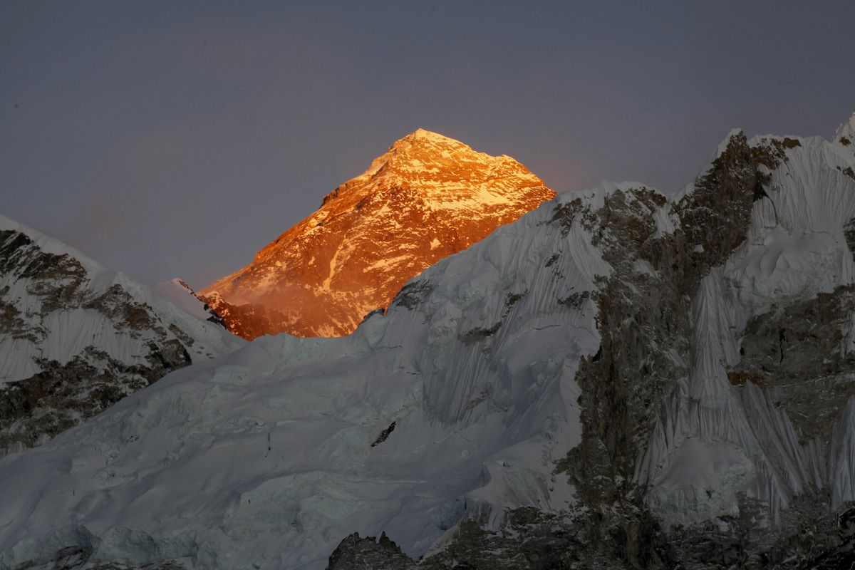 """Mount Everest is seen from Kalapatthar in Nepal. China will draw a """"separation line"""" atop Mount Everest to prevent the coronavirus from being spread by climbers ascending Nepal's side of the mountain, Chinese state media reported Monday. (AP Photo/Tashi Sherpa, File)"""