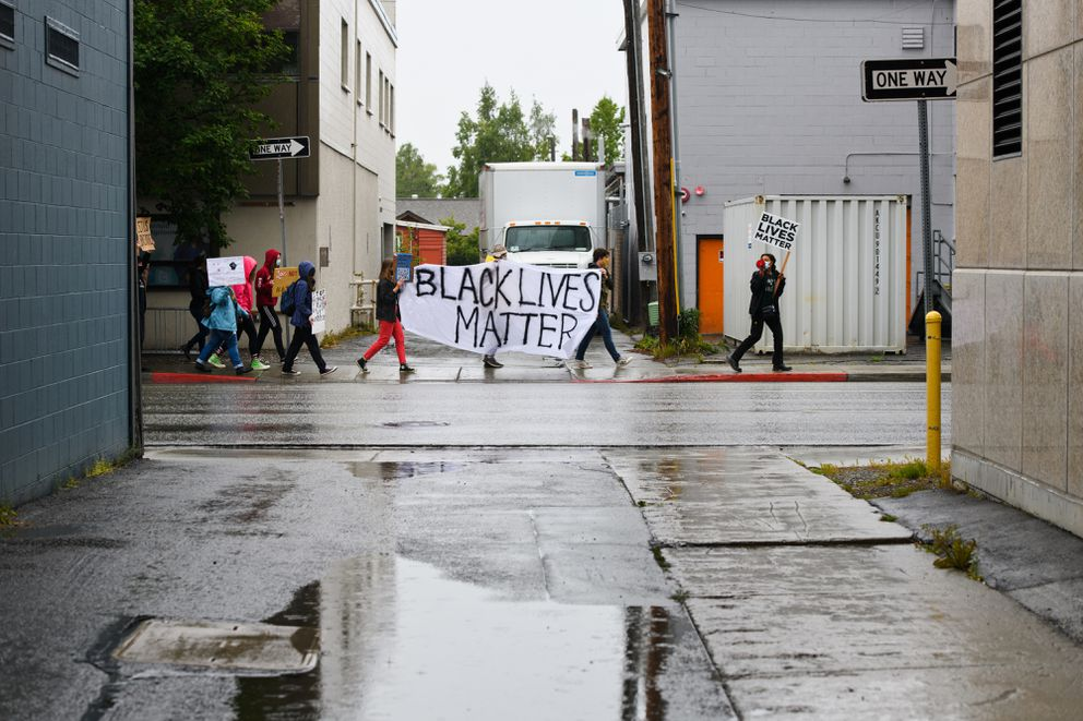 A 13-person demonstration against racism marches downtown on July 24, 2020. The event is the first of three protests organized by students of the Outer Coast Summer Seminar. (Marc Lester / ADN)