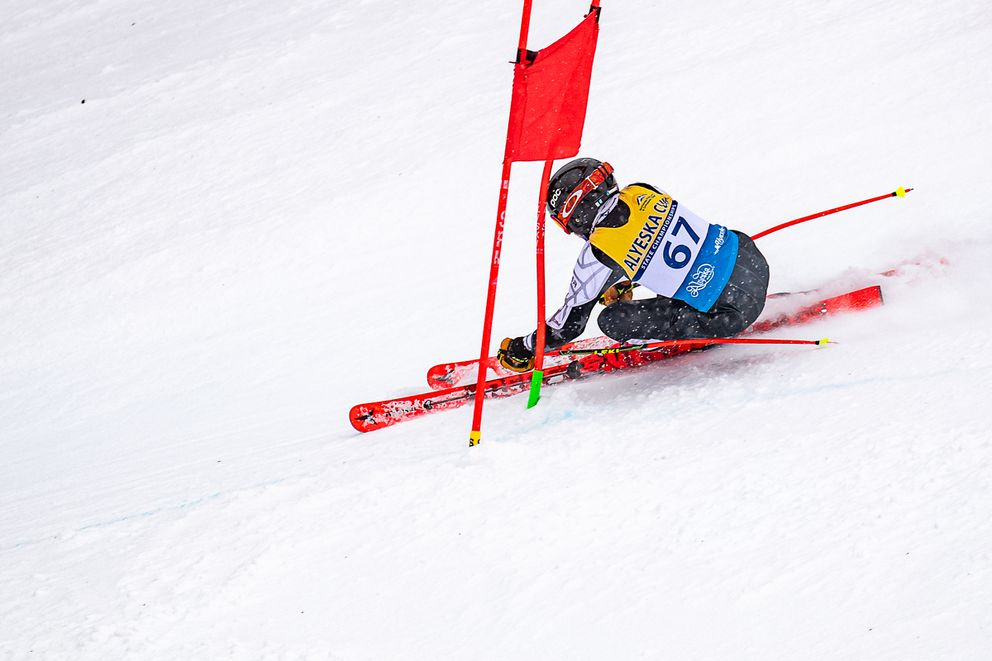 Brushing past a gate in the first of two Alyeska Cup Super-Gs on Thursday, Alyeska Ski Club U14 Carson Engstrom won his class in the second race and was second in the first race. (Photo by Bob Eastaugh)