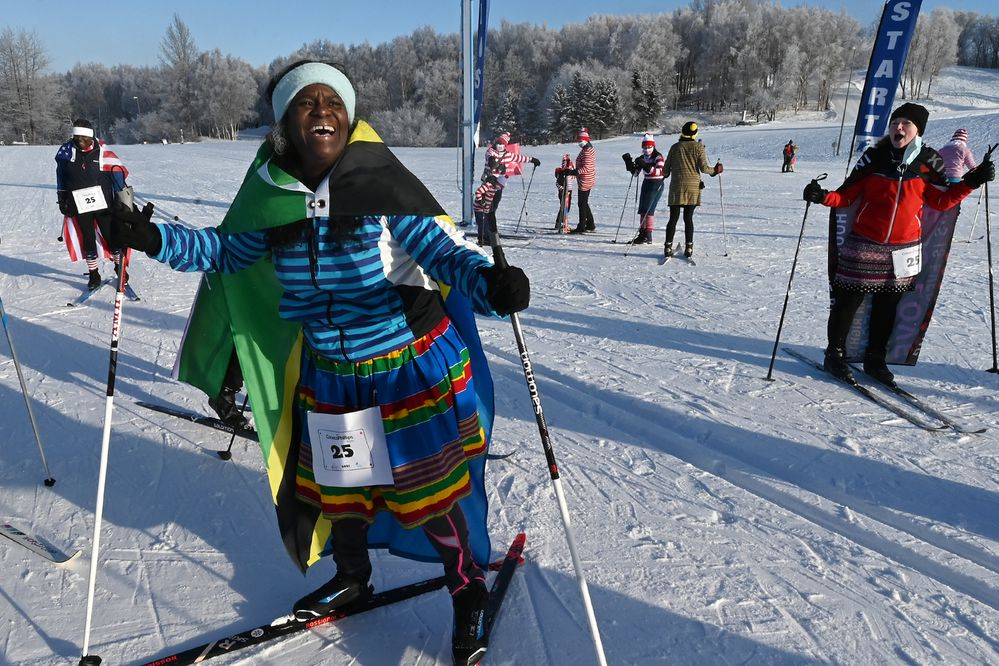 Stephanie McFadden-Evans celebrates crossing the finish line during the 25th annual Alaska Ski for Women at Kincaid Park on Sunday, Feb. 7, 2021. McFadden-Evans said she learned to ski two months ago and was part of a team called United Nations.