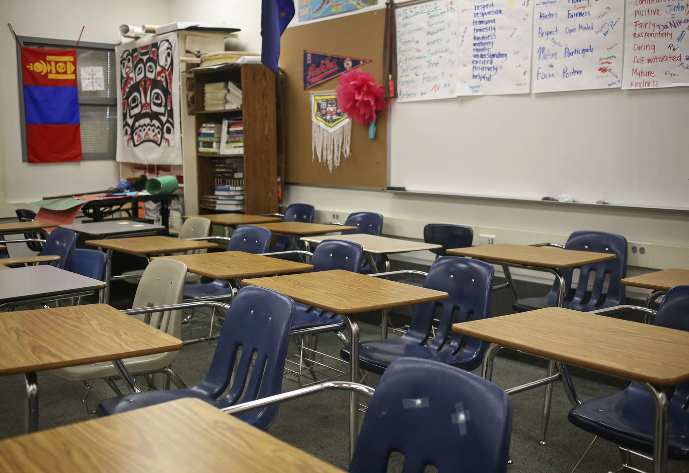 Chairs and desks remain pushed to the back of Lynda Prince's classroom on the first day of school at Bartlett High School on Thursday. (Emily Mesner / ADN)