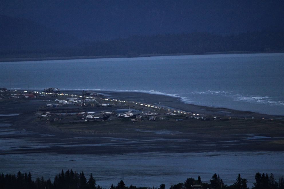 Vehicles stream from the Homer Spit after a tsunami warning sounded in Homer late Tuesday, July 21, 2020. (Pat Russell photo)