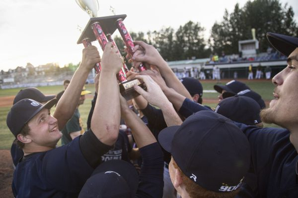 The Juneau Midnight Suns raise the first place trophy after defeating Service 3-1 in the 65th Annual American Legion Baseball Alaska State Championship game Saturday, July 29, 2017, at Mulcahy Stadium in Anchorage. (Rugile Kaladyte / Alaska Dispatch News)