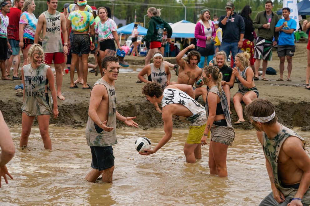A team competes in a match at the Big Lake Lions 33rd annual mud volleyball tournament on Saturday, July 25, 2020 in Big Lake. The games drew over 500 people to the day-long event, which was a fundraiser for Big Lake Lions Club. (Loren Holmes / ADN)