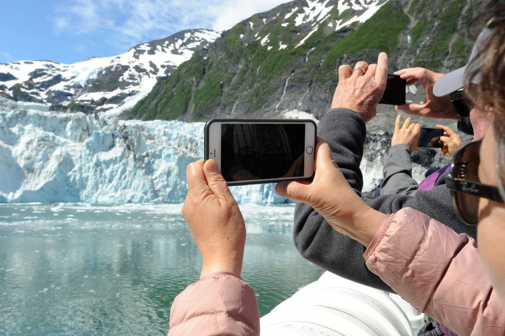Passengers aboard the Klondike Express take photos of Surprise Glacier during their Prince William Sound cruise Thursday, June 13 , 2019. (Anne Raup / ADN)