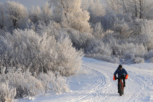 Mark Selland rides a fat bike at Point Wornozof during the cold weather on Sunday, Jan. 5, 2020. (Bill Roth / ADN)
