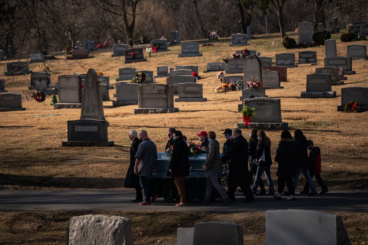 A family carries the casket of a covid victim, who died in his 50s, at a Hagerstown, Md., cemetery in January. Almost three-fourths of the decline in U.S. life expectancy last year is attributed to deaths from covid-19, according to the National Center for Health Statistics. MUST CREDIT: (Photo by Salwan Georges / The Washington Post)
