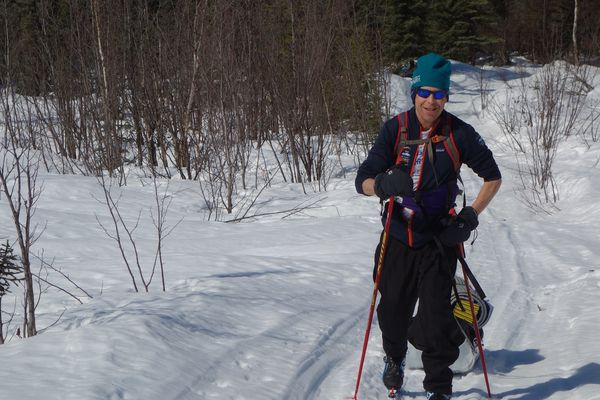 Andy Sterns skis to a rental cabin not far from Fairbanks. (Photo by Ned Rozell)