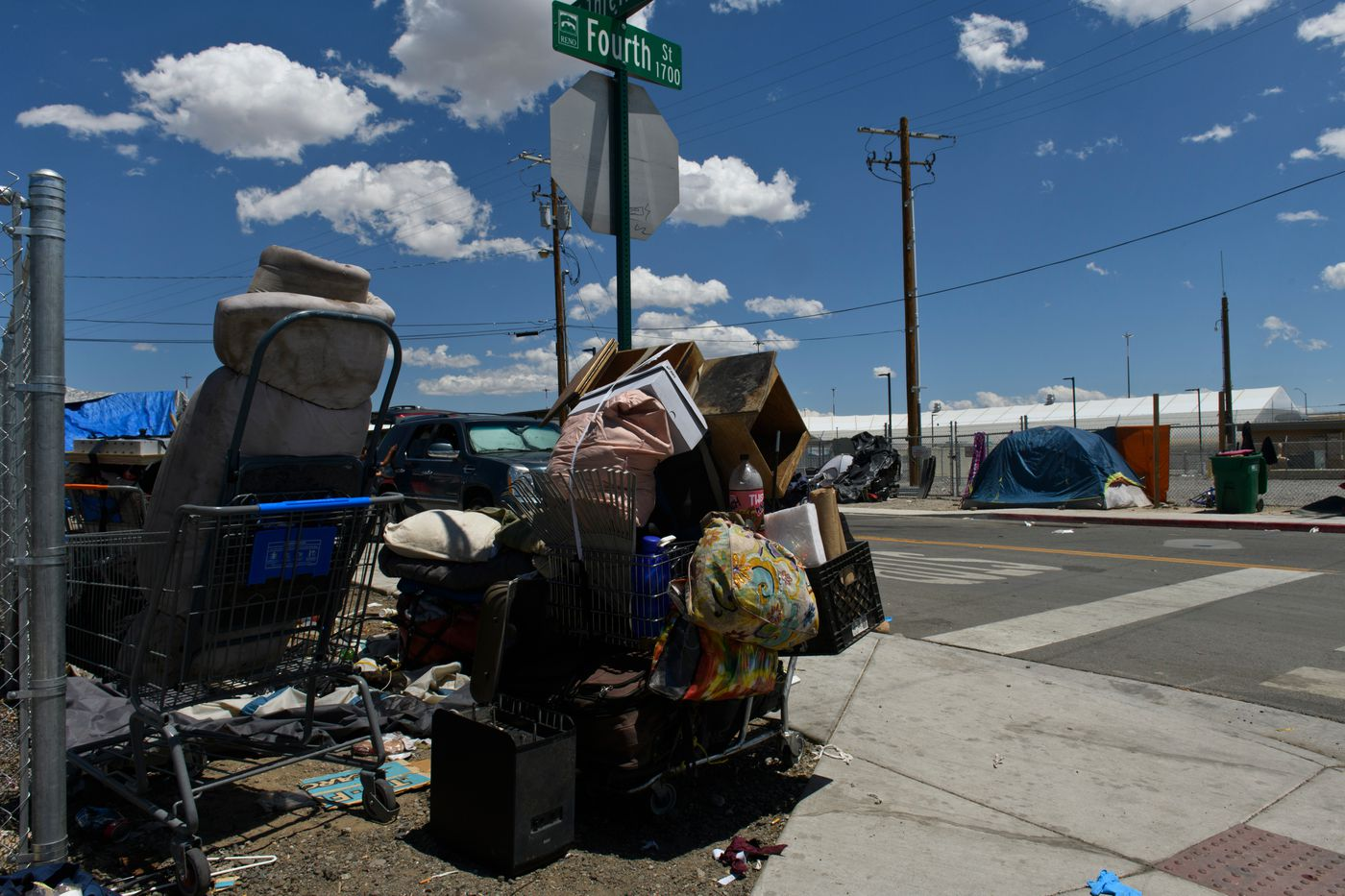 A small homeless encampment sits outside the Nevada CARES Campus entrance on June 23, 2021. Some members of Reno's homeless community said they aren't interested in staying inside the facility. The city cleared several large encampments in Reno once the Cares Campus opened in May. (Marc Lester / ADN)