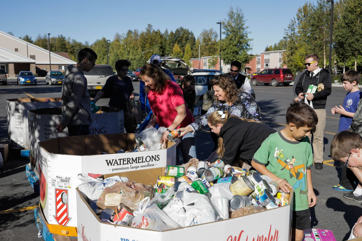 Volunteers sort donated food for the Food Bank of Alaska on Saturday, Sept. 10, 2016. The Feeding Our Neighbors food drive was organized by the Church of Jesus Christ of Latter-day Saints. (Loren Holmes / Alaska Dispatch News)
