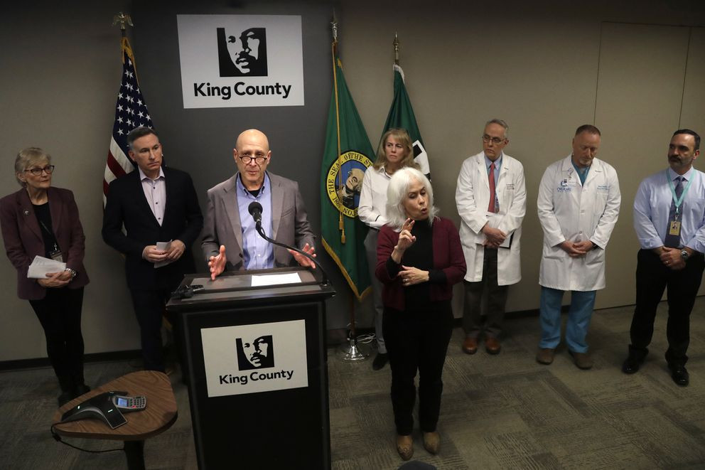 Dr. Jeff Duchin, Health Officer, Public Health – Seattle & King County, addresses a news conference, Saturday, Feb. 29, 2020, in Seattle. A man in his 50s with underlying health conditions became the first coronavirus death on U.S. soil. The man had underlying health conditions and no history of travel or contact with a known COVID-19 case, health officials in Washington state said. A spokesperson for EvergreenHealth Medical Center said the person died in the facility in the Seattle suburb of Kirkland. (AP Photo/Elaine Thompson)