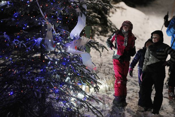 The inaugural Solstice Tour of Trees hosted by the Nordic Skiing Association of Anchorage was wildly popular as people skied and walked the Mize Loop at Kincaid Park on Sunday, Dec. 18, 2016, during the community celebration of snow, Winter Solstice, and holiday trees. (Bill Roth / Alaska Dispatch News)