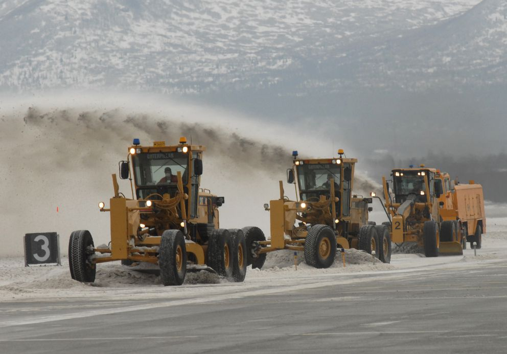 Field maintenance crews at Ted Stevens Anchorage International Airport used snow to help absorb and remove volcanic ash from Mount Redoubt on Sunday, March 29, 2009. (Bill Roth / ADN)