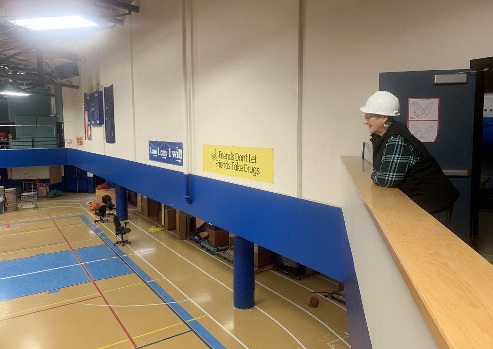 Linda Landers looks at the gym floor during a walk-through of Gruening Middle School held for community members. (Matt Tunseth / ADN)