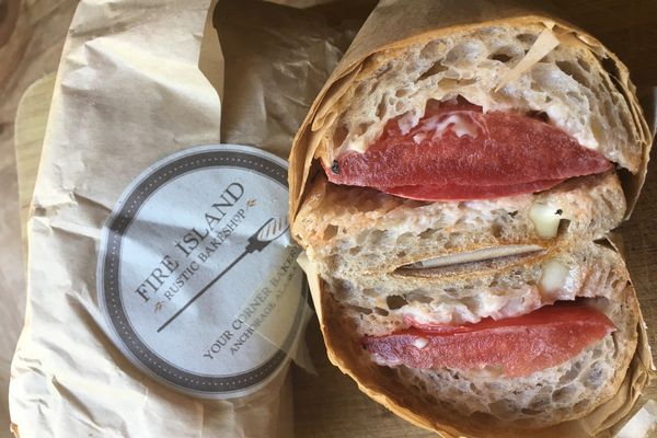 """Big, Messy Tomato"" sandwich at Fire Island Bakery ($11 each). (Photo by Mara Severin)"