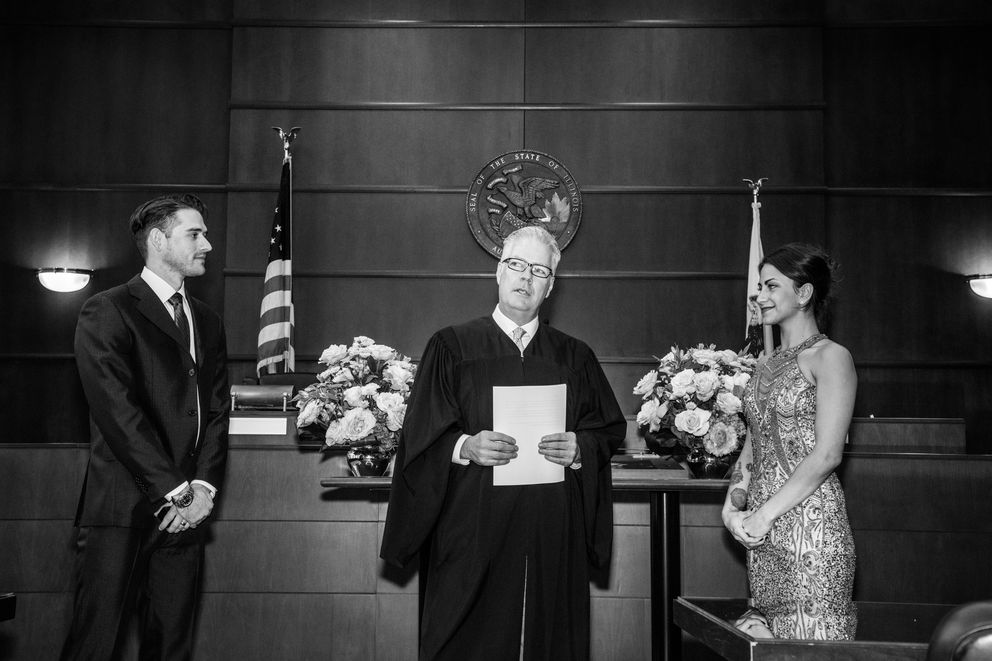 Justice Terrence Lavin officiates the wedding of Ashley Volk and Sam Siatta, in Chicago, Oct. 31, 2017. (Devin Yalkin/The New York Times)