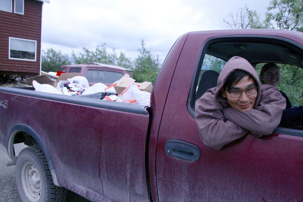 Merrill Lake helps Jesuit volunteer Cece Franko (driving) take a load to the dump as the longtime Jesuit volunteer house in Bethel is cleared out. (Lisa Demer / Alaska Dispatch News)