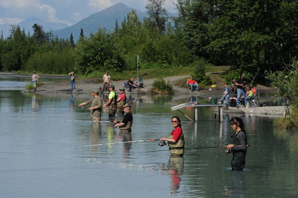 Priscilla Hunter, red shirt, teaches her granddaughter Emily Charles, 13, right, how to fish at the Eklutna Tailrace on Wednesday, July 5, 2017. King salmon are being caught daily at the fishery which is open 24 hours per day and bait is allowed. (Bill Roth / Alaska Dispatch News)