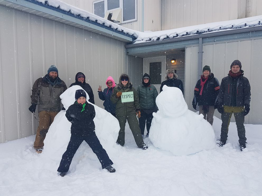 In Adak, the westernmost city in the United States, people gathered in solidarity with the Women's March movement. A group of 10 people took to slick, snowy roads despite the wind and snow on Saturday. (Nicole Gordon)