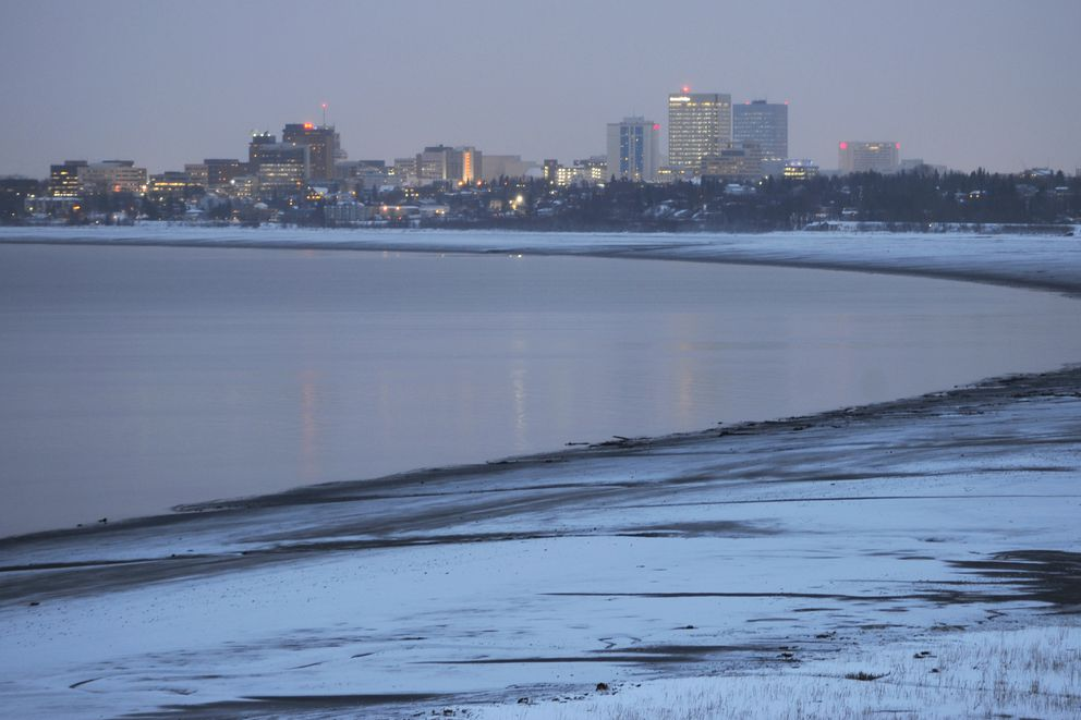Anchorage skyline and mudflats after sunset on Wednesday, Dec. 12, 2018. (Bill Roth / ADN)