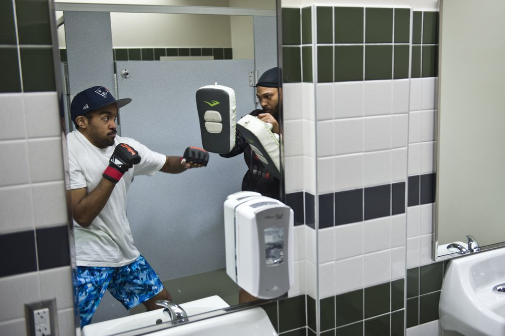 Cole Aquino, left, warms up in an Alaska Airlines Center dressing room before the event starts. Alaska Fighting Championship began its season on September 19, 2018, at the Alaska Airlines Center. (Marc Lester / ADN)