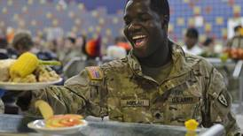 A JBER tradition: Officers dish up hearty Thanksgiving meal to soldiers far from home