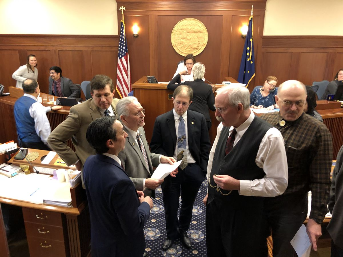 Senators discuss amendments to Senate Bill 234, which would extend the coronavirus state of emergency through Sept. 1, during a meeting of the Alaska Senate on Tuesday, March 24, 2020. (James Brooks / ADN)