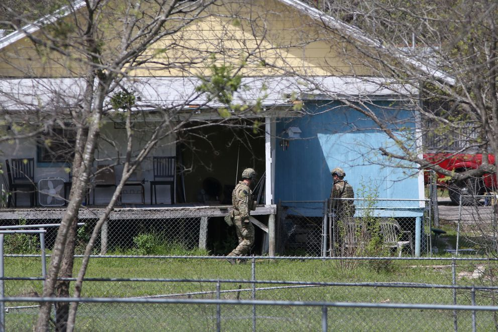 Law enforcement personnel investigate a home where the bomber was suspected to have lived in Pflugerville, Texas. REUTERS/Loren Elliott