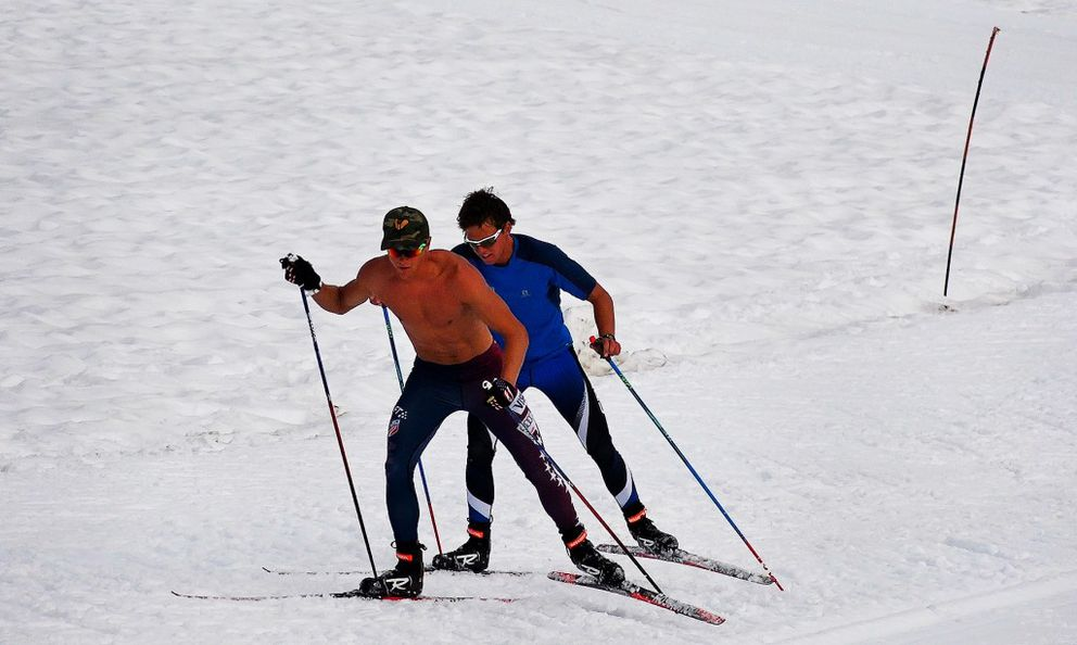 Erik Bjornsen, in front, and Scott Patterson sprint up a short hill during summer training on Eagle Glacier on Monday. (Scott Jensen / Alaska Dispatch News)