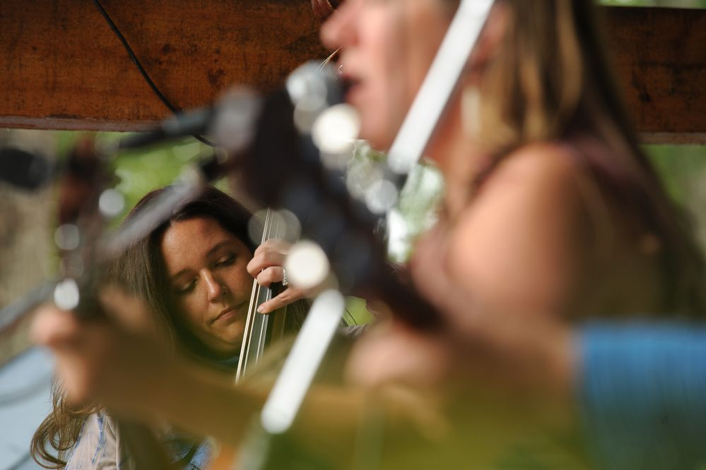 Dawn Campbell and Melissa Mitchell perform with the Hope Social Club at the Girdwood Forest Fair on Saturday, July 2, 2016, in Girdwood AK. The 41st annual fair featured music, food, crafts and a hippie vibe. (Bob Hallinen / Alaska Dispatch News)