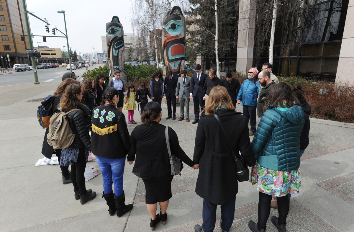 Alaskan youth plaintiffs and supporters pray outside the Nesbett Courthouse on Monday, April 30, 2018, before a hearing on the Sinnok vs. State of Alaska climate lawsuit brought by 16 young Alaskans. A superior court judge heard oral arguments on the State's motion to dismiss the case. (Bill Roth / ADN)