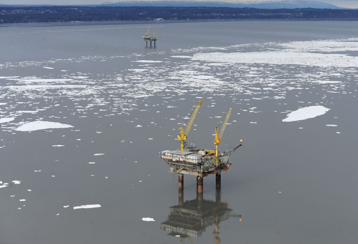Workers on Hilcorp's Anna platform, foreground, discovered a sheen of oil at about 11:20 a.m. Saturday after they felt a violent shudder to the platform. The platform is about 45 miles southwest of Anchorage near the village of Tyonek, on the west side of Cook Inlet. The Bruce platform is visible in the distance on Sunday, April 2, 2017. (Bill Roth / Alaska Dispatch News)
