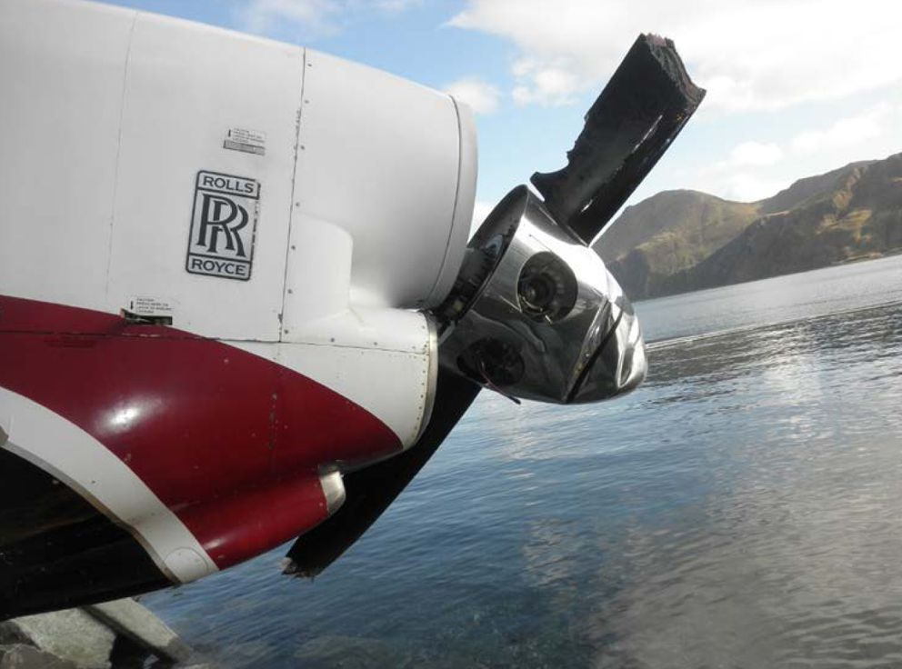 Damage to the left propeller of a Saab 2000 twin-engine turboprop that crashed Oct. 17 at the Unalaska airport. (National Transportation Safety Board photo)