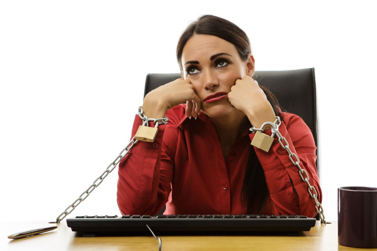 You're not literally chained to your work. But your employer has broad leeway over how to grant paid leave — or whether to grant it at all.(Thinkstock)