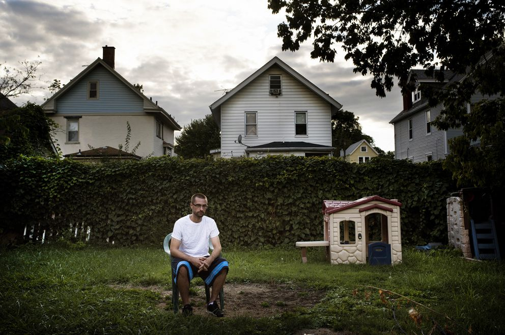 John Hatmaker, 29, sits in the backyard of his grandparents' home in Norwood, Ohio, on Thursday. Hatmaker is one of more than 200 people to overdose in the Cincinnati area in the past two weeks, leaving three people dead in what the officials here called an unprecedented spike. Carfentanil, an animal tranquilizer, was believed responsible for many of the overdoses. (Ty Wright / The New York Times)