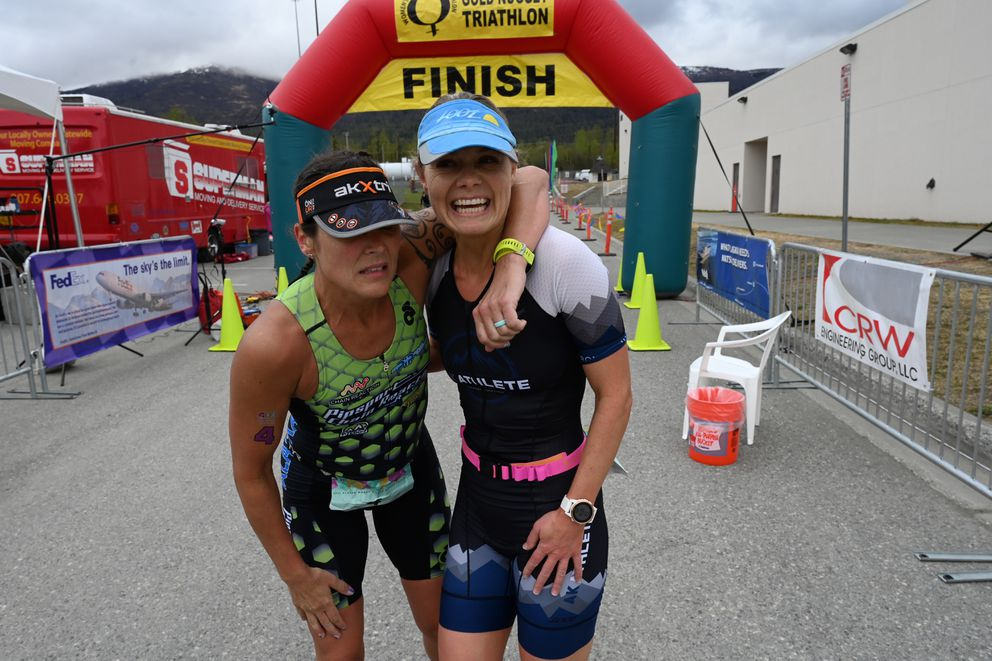Amber Stull, left, and Kristina Eaton recover after their sprint finish. (Bill Roth / ADN)