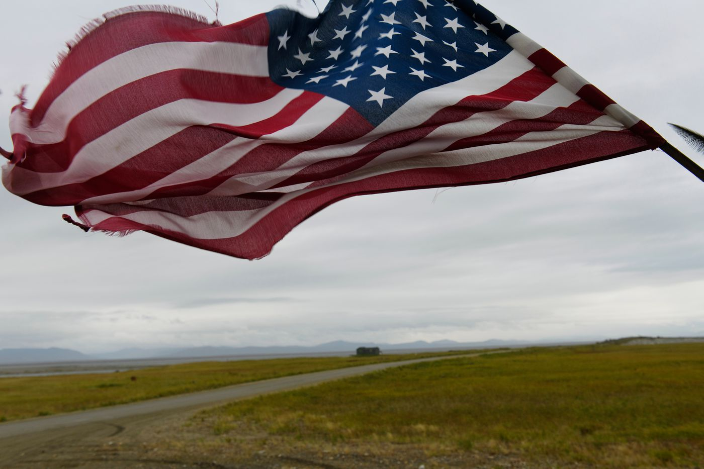 An American flag waves in the breeze on the porch of the Safety Roadhouse. (Marc Lester / ADN)