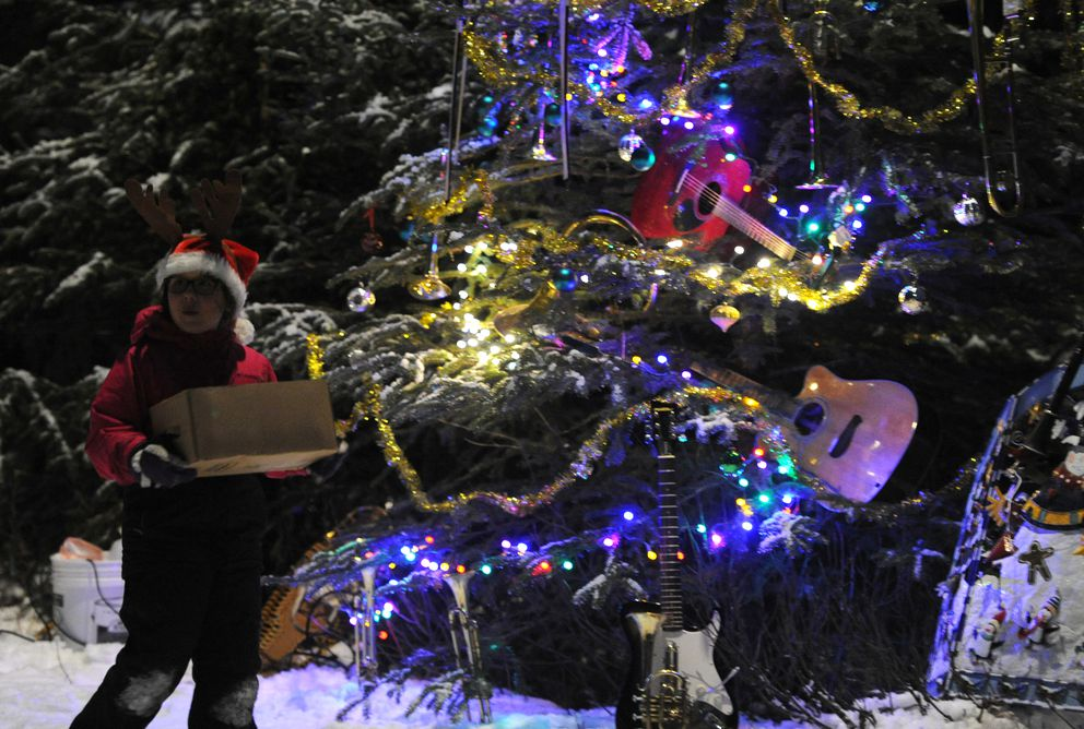 Instruments adorn a tree decorated by Alaska Music and Sound at the inaugural Solstice Tour of Trees last year at Kincaid Park. (Bill Roth / ADN archive 2016)