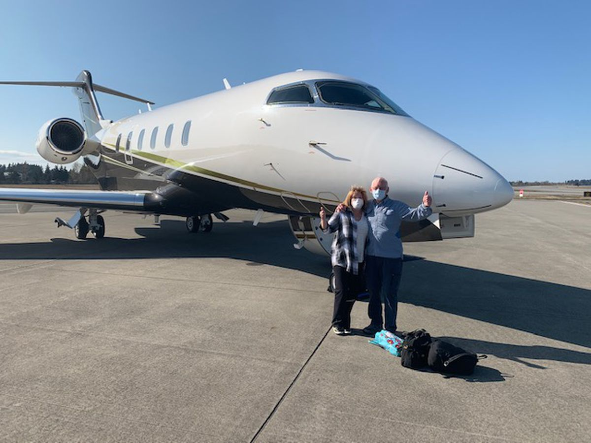 Susie and Dave Schaefer wear masks as they prepare to board a chartered plane to take them home to Alaska. The Wasilla couple contracted COVID-19 while aboard the Coral Princess cruise ship. (Photo courtesy of Susie Schaefer)