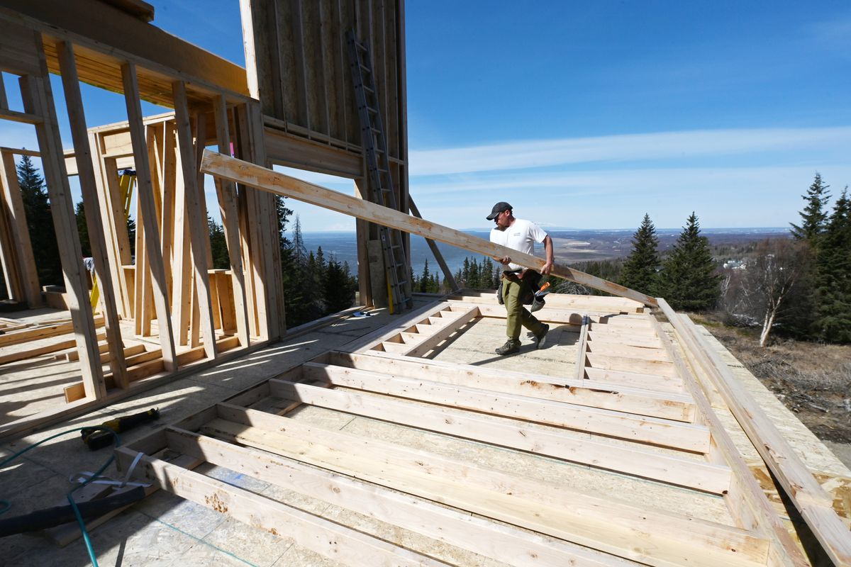Tim Plum, owner of AK Nailer Construction, frames a single family home in Potter Highlands on Tuesday, April 27, 2021. Lumber and building materials have skyrocketed during the pandemic. (Bill Roth / ADN)
