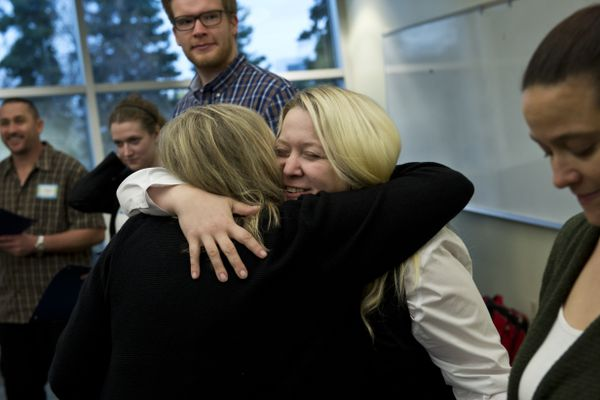 Ruthanna Carr, facing, hugs fellow inductee Stacy Hawkins. Fifteen UAA students were inducted into Delta Alpha Pi, an honor society for high-achieving students with disabilities, on October 3, 2017. The organization aims to provide advocates and role models for students with disabilities. (Marc Lester / Alaska Dispatch News)