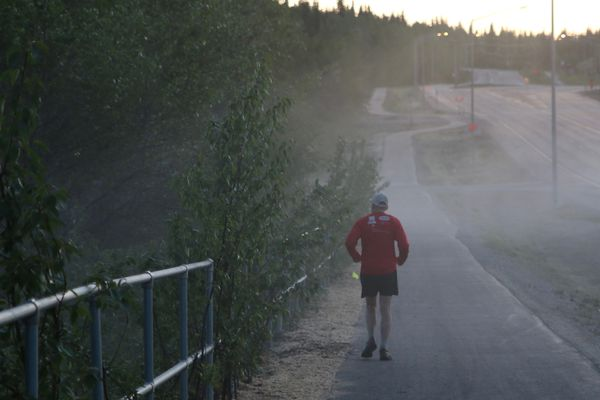 Ned Rozell runs through the mist coming off Ballaine Lake at 2 a.m. during the Alaska Endurance Trail Run. (Chris Carlson)