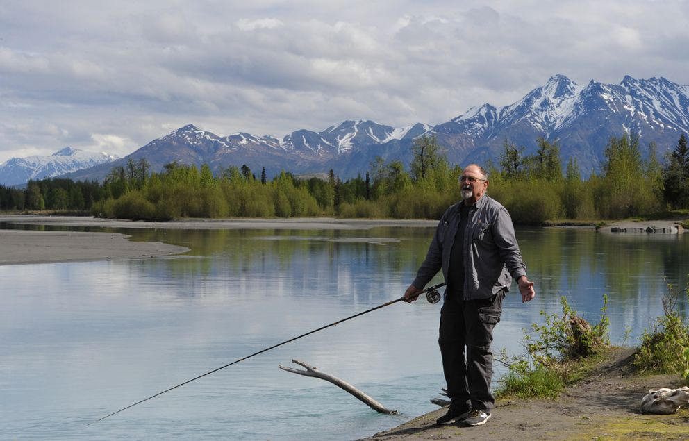 "Glen Rouse, who recently retired from teaching at Palmer High School, enjoys the day while fishing for king salmon on the Knik River near the Eklutna Tailrace on Thursday. Rouse said, ""In a week to 10 days, this place is going to be smokin' hot."" (Bill Roth / ADN)"