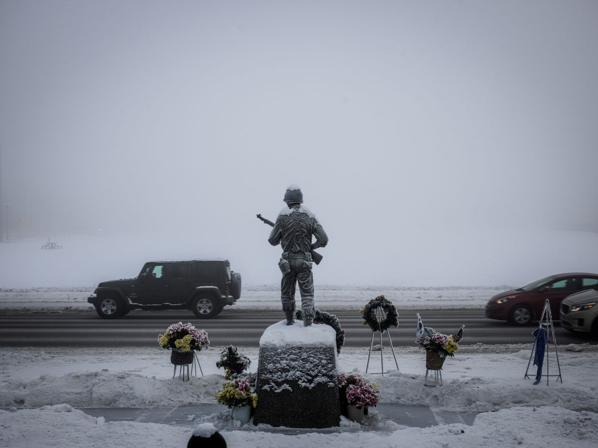 Drivers pass the roadside Veterans Memorial in downtown Anchorage. (Ash Adams for The Washington Post)