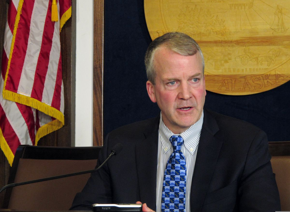 U.S. Sen. Dan Sullivan speaks to reporters after giving his annual address to a joint session of the Alaska Legislature on Thursday, Feb. 21, 2019, in Juneau, Alaska. Sullivan said he did not think a 90-day comment period was adequate for a draft environmental review of the proposed Pebble Mine project in Alaska's Bristol Bay region. (AP Photo/Becky Bohrer)