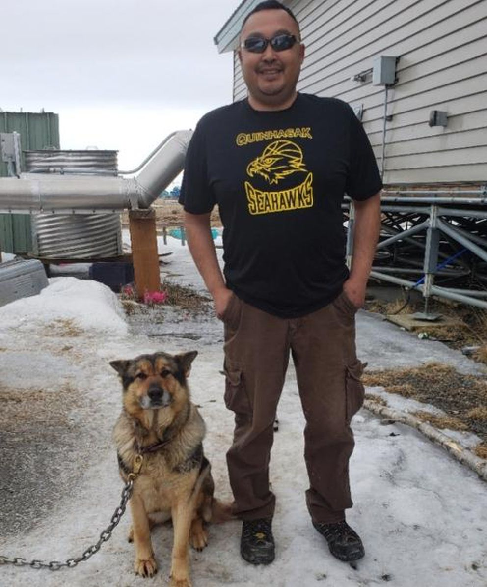 Johnathan Alexie with his dog, Lexi, who was attacked by a coyote two weeks ago. (Photo courtesy Johnathan Alexie via KYUK)